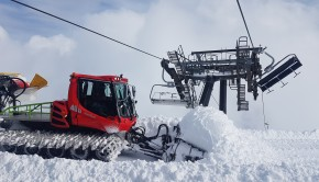 Snow groomer clearing snow left by the avalanche which damaged the High Noon Express Chairlift