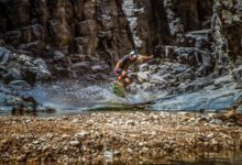 Photo of Local Bedouin people help American navigate narrow gorges in Jordan.