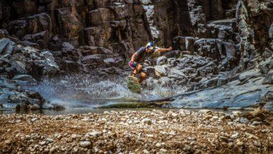 Photo of Local Bedouin people help American navigate narrow gorges in Jordan.